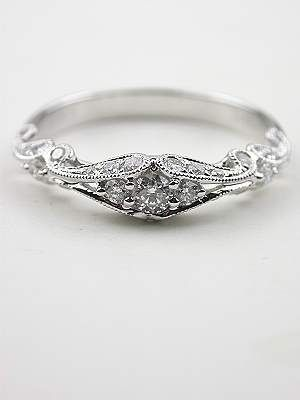 Swirling Diamond Wedding Band.. next to the engagement ring.. yess