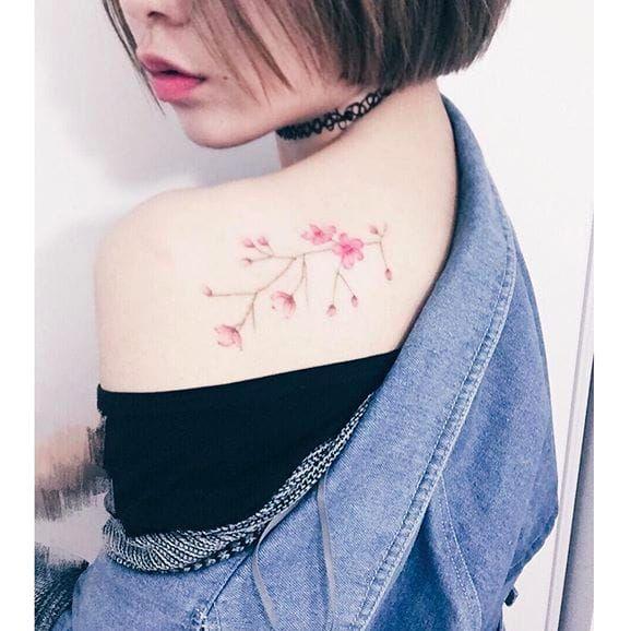 Pretty Sakura tattoo by Helen Xu via Instagram @helenxu_tattoo floral daintyflower watercolor watercolorpainting watercolorart sakura linework flowers