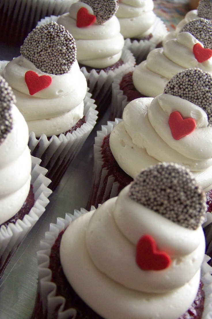 Red Envy Cupcakes - Red Velvet cake adorned with a Dark Chocolate non-pareils then a heart