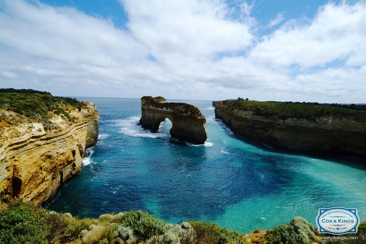 Wish you were here? Take a helicopter ride over Port Campbell on our self-drive Melbourne adventure! #CoxandKings