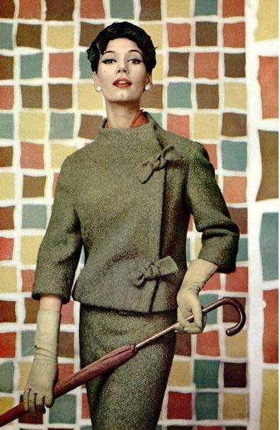 Simone D'Aillencourt in Christian Dior, 1957.  Elegance of the pencil skirt mirrored in the umbrella - lovely.