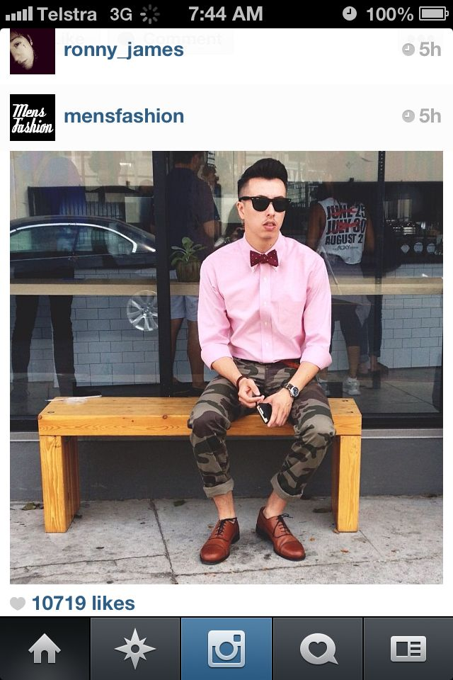 Camo pants, pink shirt and bow tie.