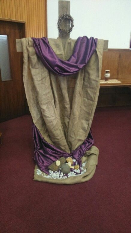 Lent stones symbolising our burdens.placed.at the foot of the cross