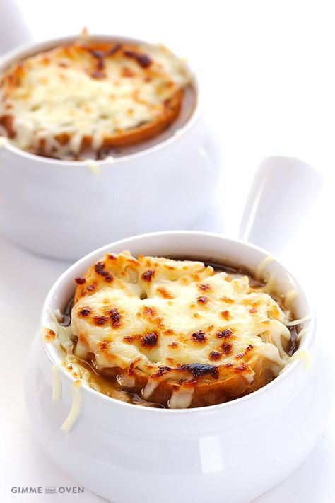French Onion Soup: INGREDIENTS:  4 pounds yellow onions, peeled and thinly sliced (approximately 5-6 large onions) 3 tablespoons butter 4 cloves garlic, minced 3 tablespoons flour 1/2 cup dry white wine 6 cups of beef stock 1 teaspoon worcestershire sauce (optional) 1 bay leaf 3 sprigs of thyme (or 1 teaspoon dried thyme) a few generous pinches of salt and freshly ground black pepper, to taste baguette grated cheese (Gruyere, Asagio, Swiss, or Mozzarella)