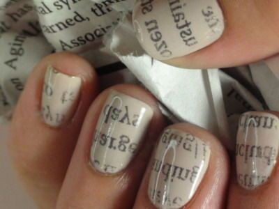 Apply base coat, dip your nails in rubbing alcohol for a few seconds, and  then put newspaper print on top.