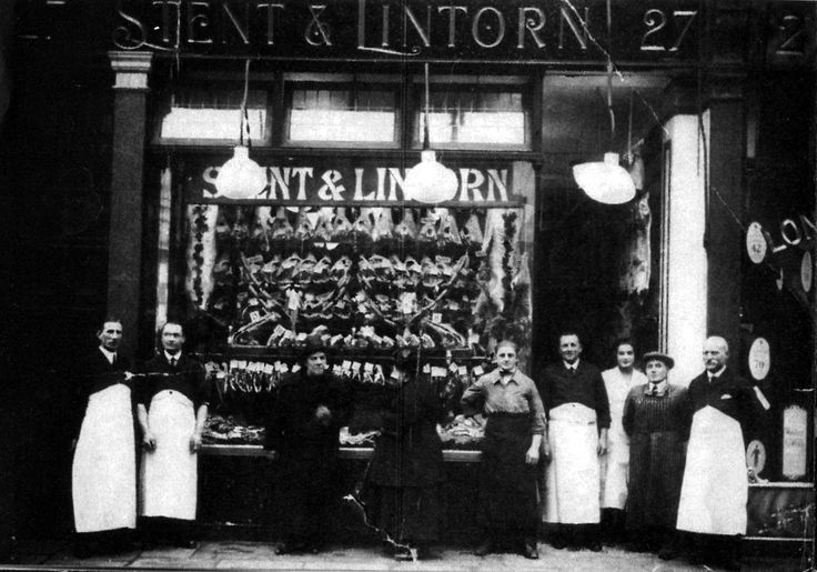 Stent & Lintorn - Butchers. Glass window with block letter branding and unique hangdown lighting