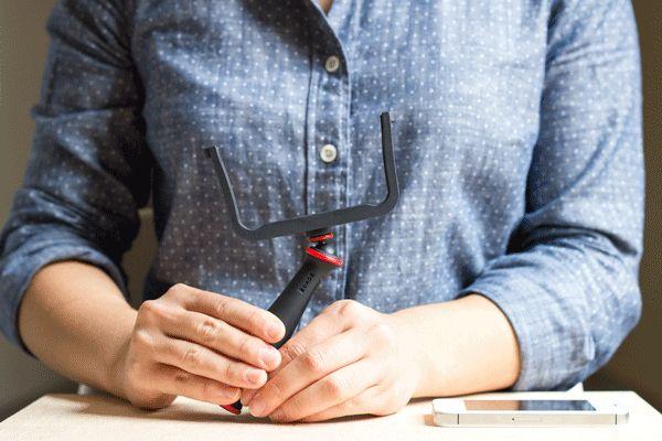 The SlingShot: A Double Duty Phone Grip and Tripod (@ Photojojo)