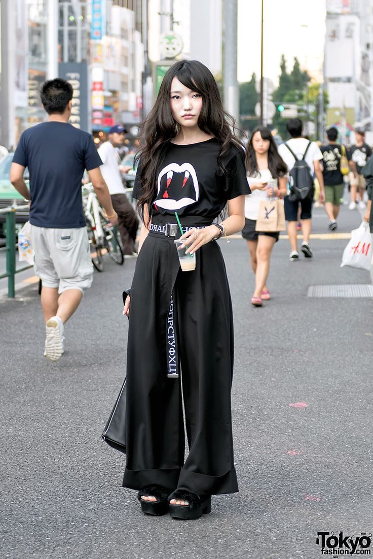 Haruka on the street in Harajuku today wearing a Saint Laurent vampire shirt, G.V.G.V. belt with Emoda wide leg pants, Pameo Pose platform sandals and vintage handbag. Full Look