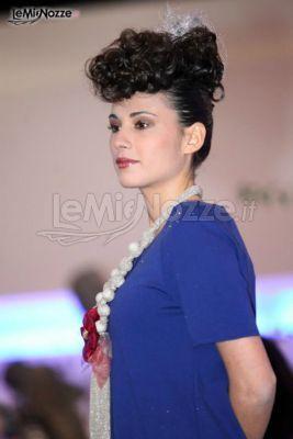 http://www.lemienozze.it/operatori-matrimonio/trucco_e_acconciatura/gidigi-parrucchieri/media/foto/4 Acconciatura raccolta con capelli vaporosi e trucco dai toni caldi.