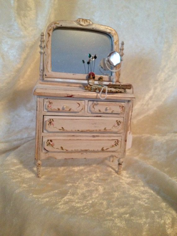 Off white snappy chic dresser.With hand painted roses.A soft piece to add to that romantic bedroom.1:12 scale 6x3 1/2