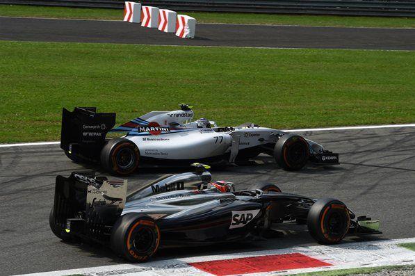 Valtteri Bottas (FIN) Williams FW36 and Kevin Magnussen (DEN) McLaren MP4-29 battle. Formula One World Championship, Rd13, Italian Grand Prix, Monza, Italy, Race Day, Sunday, 7 September 2014