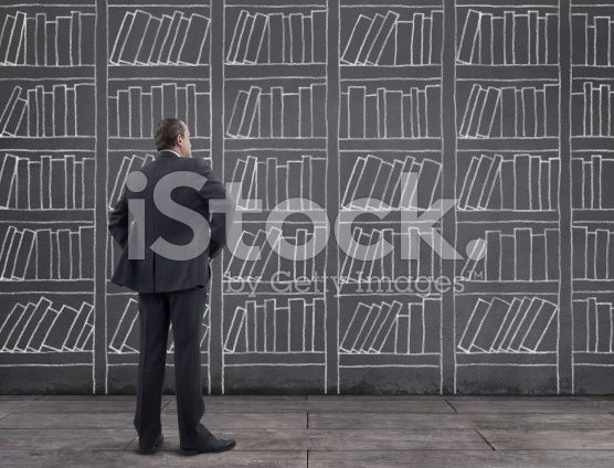 Businessman with Bookshelf Sketched on the Wall (royalty-free stock photo) © mgkaya