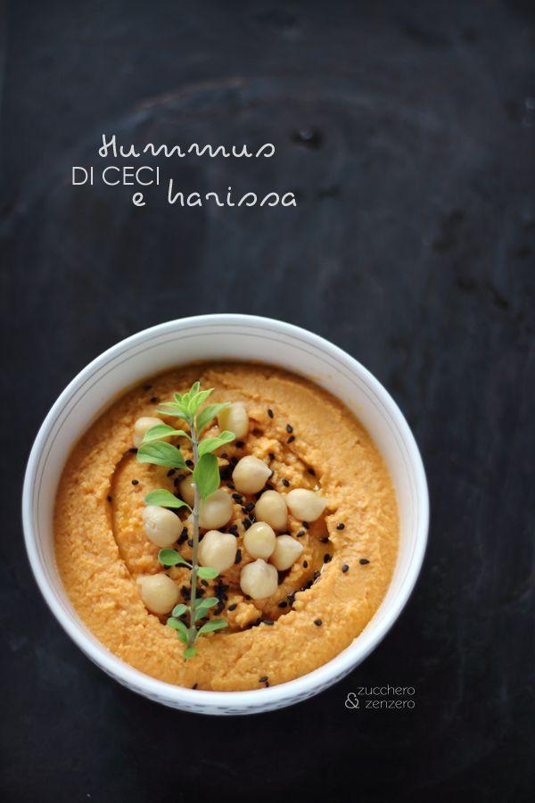 Hummus with harissa - 250 g of chickpeas, rinsed the juice of one lemon 2 tbsp extra virgin olive oil 1 tsp harissa paste salt black sesam, fresh herbs, oil to garnish