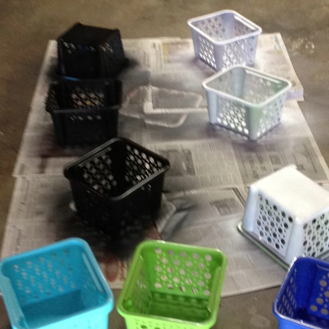 Spray paint baskets to match classroom theme. Valspar paint for plastic works great!!!!