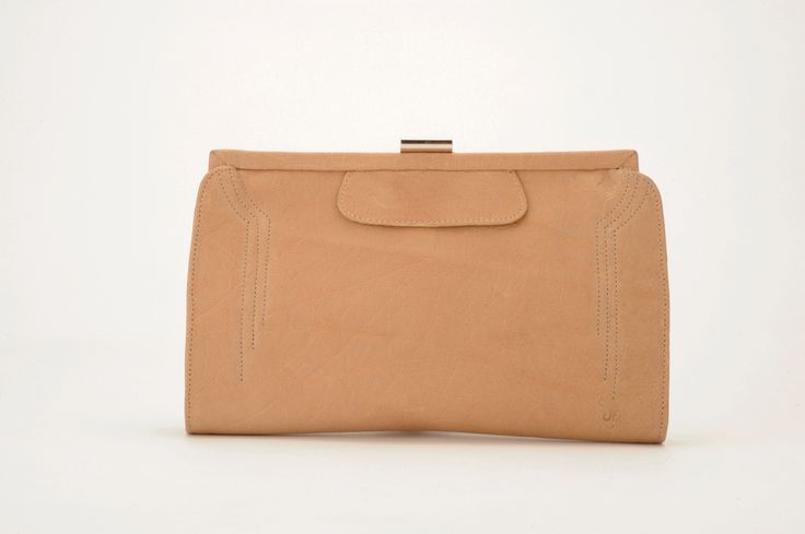 The Contessa Purse in antique tan.