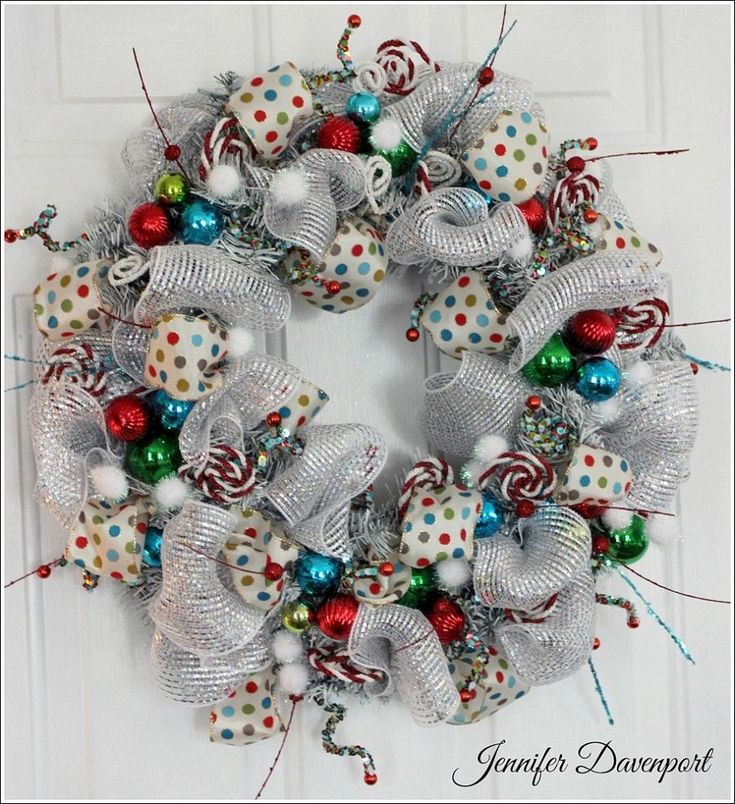 Whimsical Christmas Wreath -what fun colors. This is for sale on Etsy, but she does give applicable instructions on her website which is linked here.