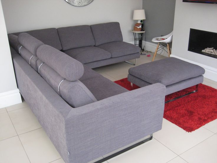 Hazel sofa modules, very contemporary low seating but with down and feather base and back cushions, so it is not too firm to sit on.  The left hand side is upholstered at the end, instead of having an arm - saving 20 cm space. We added headrests for extra height, at the customer's request.  The footstool finishes this combination off rather nicely.