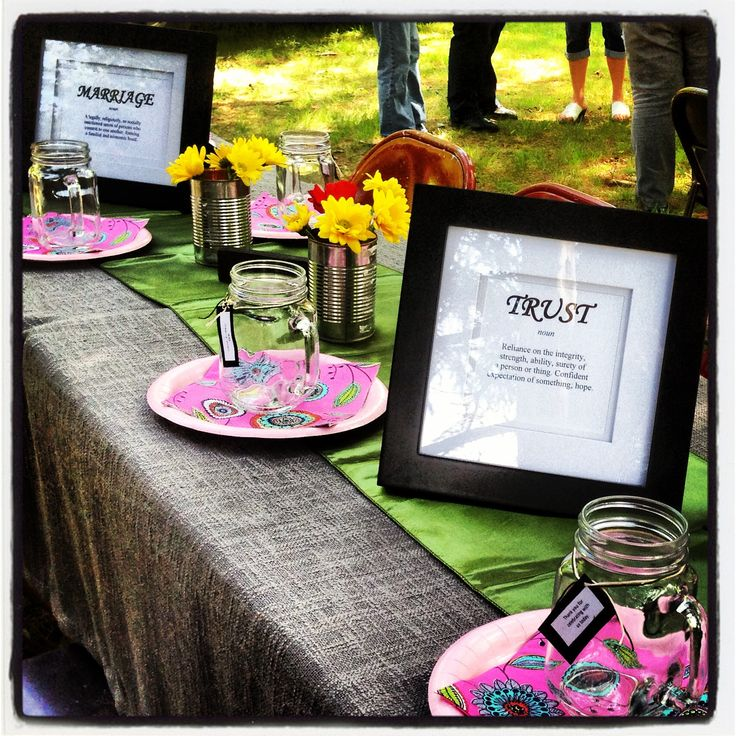 Country-sheek bridal shower on a dime! Printed definitions to insert into frames already had around the house, tin cans as vases, mugs as gift favors & curtains turned tablecloths for the day.