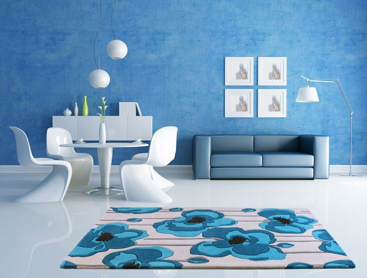 Start a new chapter of elegance in your home décor with our Burgeon Teal Floral Rug. Pure wool made this rug look so appealing with the blue coloured walls. Stain-resistant and anti-fade this rug is a must have affordable luxury for you. #luxuryrugs #woolrugs #tealrugs #bluefloralrugs #floralrugs