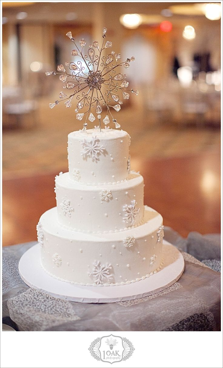 winter wedding cake snowflake. Don't care for the topper but love the snowflakes!