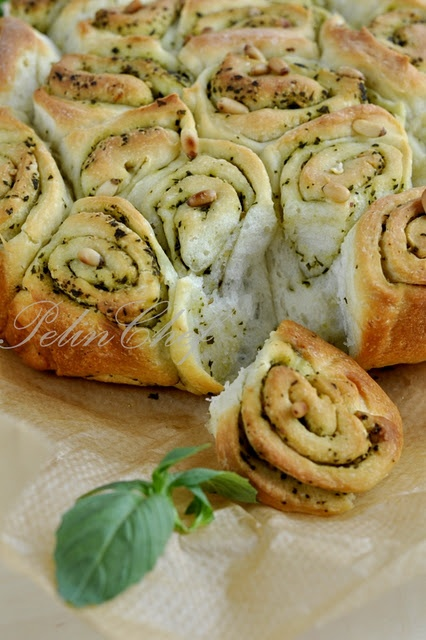 Basil Pesto Bread - press out cresent roll dough. spread pesto. roll up into a log. slice. place in a pie plate like cinnamon rolls and enjoy.