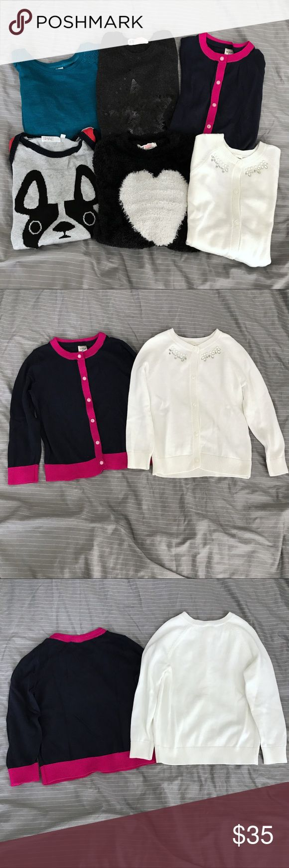 6x Toddler Girl Sweaters (3T) All size 3T or equivalent: 1. 2x H&M charcoal gray sweater w/ sequin star + black furry sweater w/ white heart (both size 2-4T)  2. 2x OshKosh Cardigans- navy w/ pink & ivory w/ jeweled neckline (this one was washed but never worn) 3. Shae- French bulldog intarsia gray sweater (small stain on front near bottom, tag is detached on one side, size 2T but runs large) 4. Old Navy- lightweight teal swing sweater, lace details at shoulders OshKosh B'gosh Shirts & Tops…