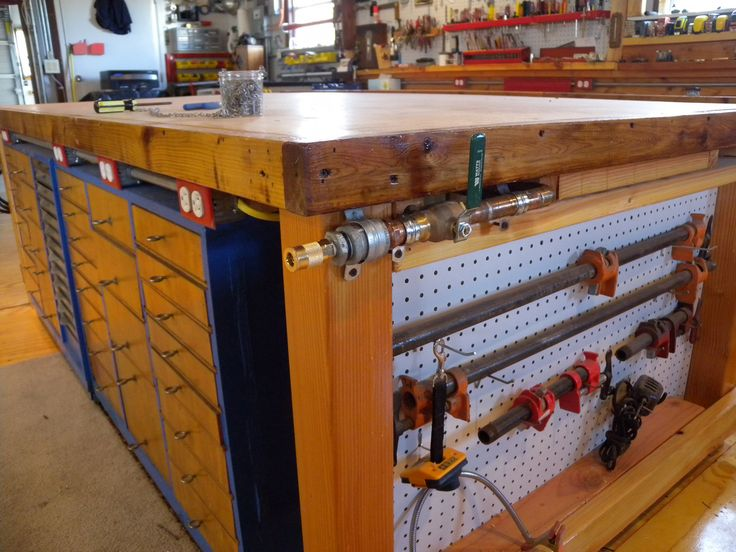 Tool Bench Organization Ideas Part - 44: Center Bench With Storage Under And What Looks Like Compressor Piping For  Easy Access.