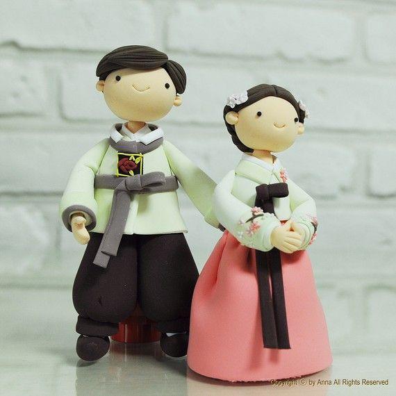 Hey, I found this really awesome Etsy listing at http://www.etsy.com/listing/70343828/korean-hanbok-custom-wedding-cake-topper