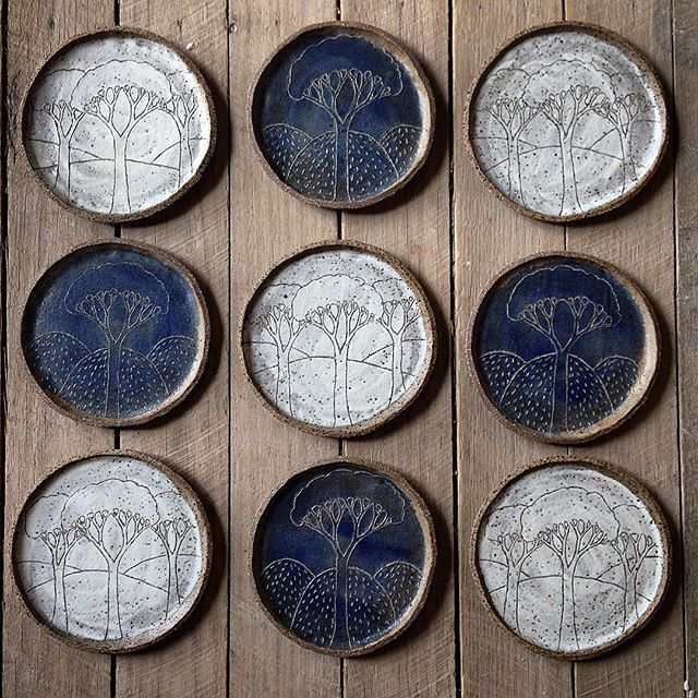 Night and day side plates hot out of the kiln.  #australianceramics#ceramics#pottery#sideplates#plates#tree#mountain#mountainclay