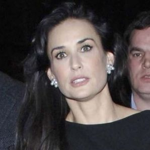 Demi Moore and Ashton Kutcher played dominoes for charity Thursday night.      The pair were taking part in the third annual Pre-Oscar Hollywood Domino Gala charity event alongside a number of celebrities including Eva Longoria Parker, Kelly Brook, Jamie Foxx and Nicky Hilton.    The event, which took place at Bar 210 at the Beverly Hilton hotel, was not a comfortable one for British actress Kelly, whose ex-boyfriend Jason Statham was also in attendance.
