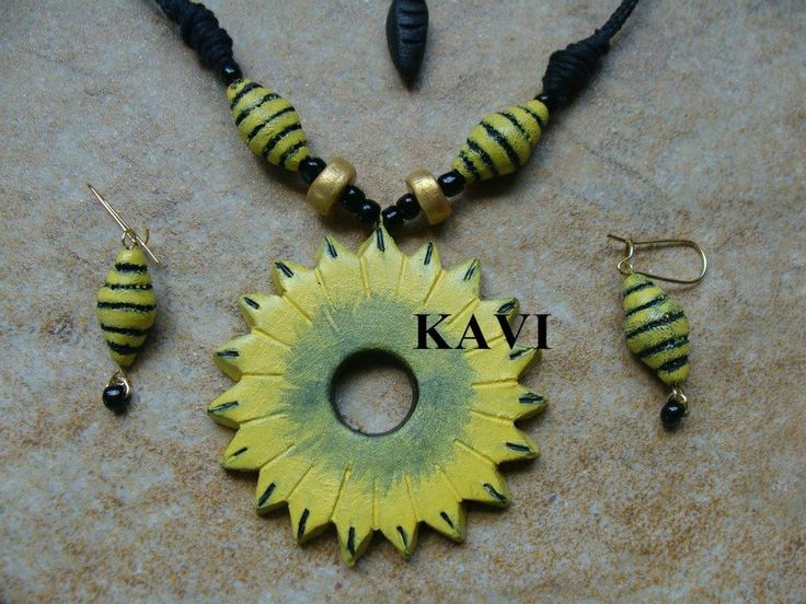Simple handmade terracotta jewelry painted on yellow acrylic https://www.facebook.com/KavisTerracottajewellery