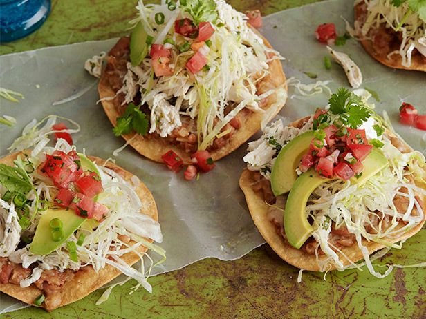 Chicken Tostadas : Fry tortillas until very crispy (otherwise they will become rubbery), then top them with a mixture of chicken, beans, avocado, lettuce and salsa. via Food Network