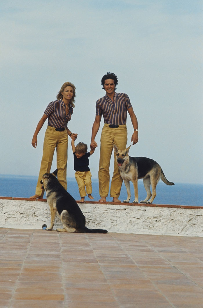 Nathalie Delon and her family (husband, child, German shepherds) in St. Tropez.