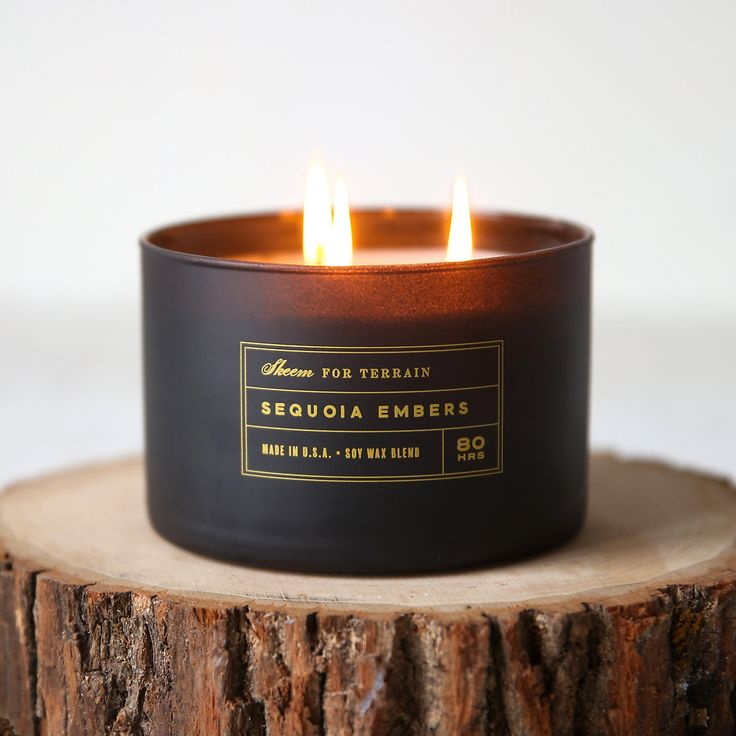 "Hand-poured exclusively for terrain and topped with a maple wood lid, this soy wax candle from Skeem pairs woodsy amber, patchouli, and sequoia with a smoky base and hints of fruit and spice.- A terrain exclusive- Maple wood lid, matte glass vessel, soy wax- Triple cotton wick - 80 hour burn time- 24 oz.- Hand-poured in the USA3.5""H, 4.75"" diameter"
