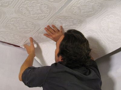 How to Hang Wallpaper on a Ceiling  Add texture and style to a plain ceiling by applying embossed wallpaper.    More in Home