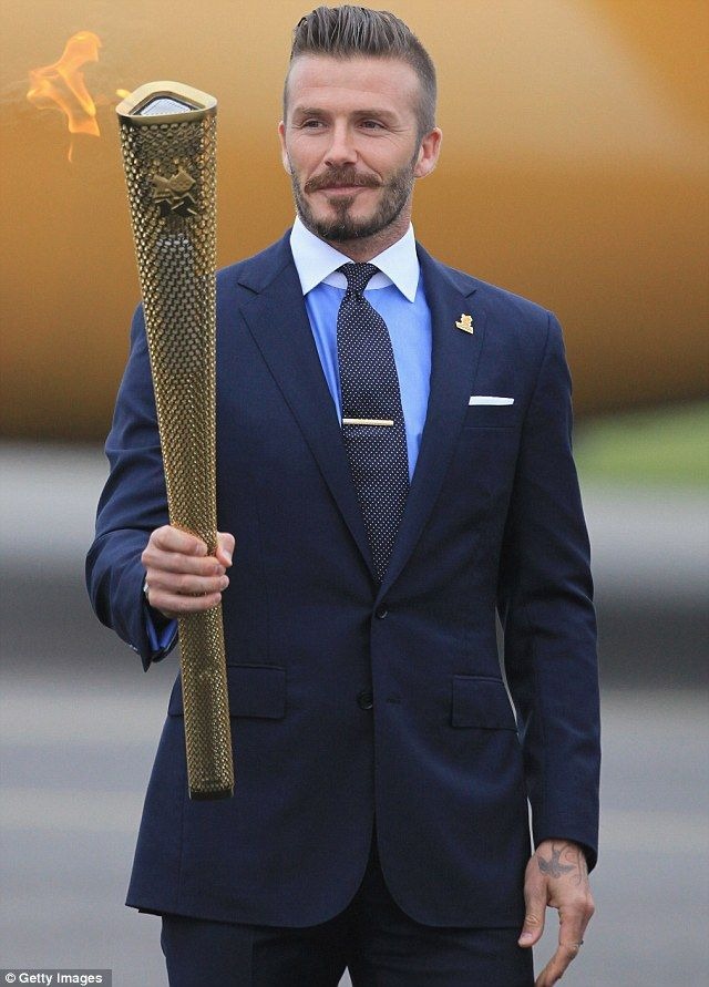 Top tips: David Beckham has listed his top ten recommendations for things to do in London during the Olympics. The idol is pictured here with the games torch #olympics
