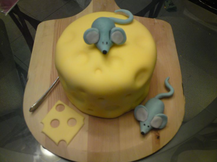 "Mice on cheese - Vanilla sponge cake with vanilla pudding filling. Cake covered in fondant, sugarpaste mice and cheese slice. Note: if you want to make the ""holes"" on the cheese, use the end of a wooden spoon. I waited a long time to make this cake because I couldn't figure out how to do it!"