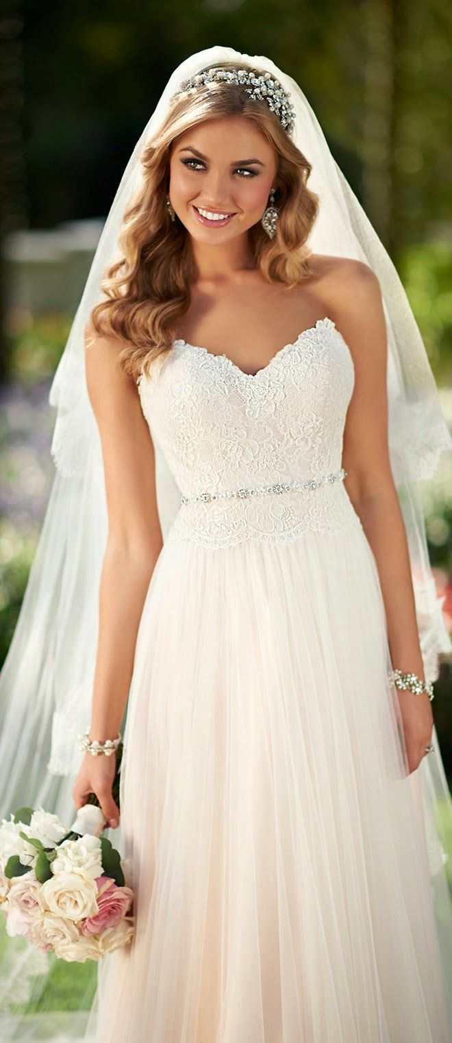 love the heart shaped bustline on this chiffon wedding dresss