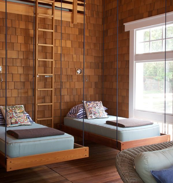 Simple and stylish hanging beds in a room clad in wooden tones