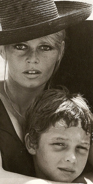 Brigitte Bardot with her son - 1967  wow! what a photo!...the woman I always wanted to look like, and her look-alike, Claudia Schiffer!! :)Lo