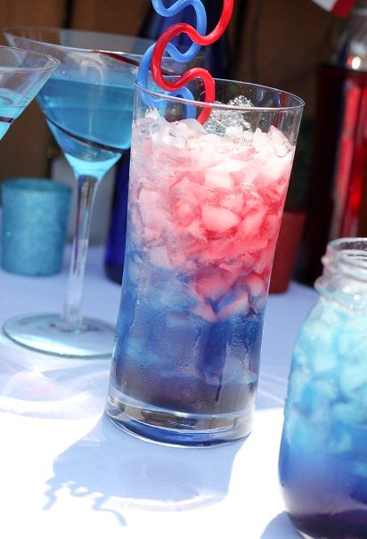 Bomb Pop cocktail recipe. Option 1:  Lemonade, Mike's Hard Cranberry, UV Vodka Blue. Option 2:  Smirnoff Ice, Blue Curacao, Cranberry Juice. Option 3:  2 oz Bacardi Razz rum, 2 oz lemonade, 2 oz Blue Curacao.  Option 4: 1/2 shot Cherry Vodka, 1/2 shot Blue Curacao, drizzle grenadine, 1/2 bottle Smirnoff Ice