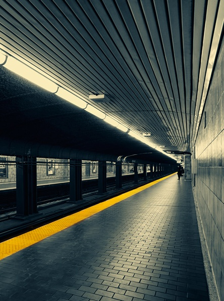 This photo shows negative space because it is empty in the subway