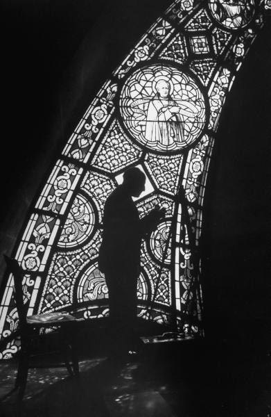 Alfred Eisenstaedt working in cathedral on assignment, Lourdes, France