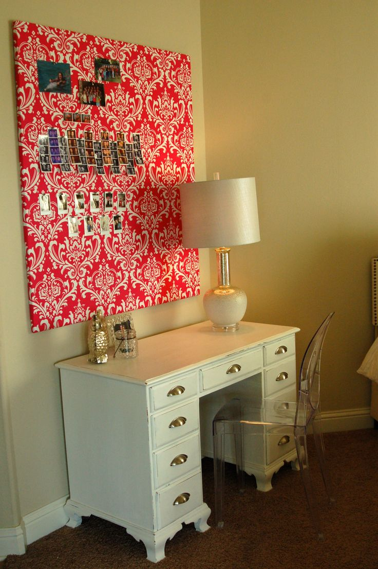 For this teenage girl's small bedroom I went hunting for a small antique desk. I found an old black one and painted it with two coats of Annie Sloan Chalk paint in Pure White, rubbed on some wax, changed the hardware and called it done! Love that stuff! For the small opening I found a ghost chair that was a perfect juxtaposition to the traditional desk. I covered a piece of foam insulation board with a pink damask fabric to make a bulletin board and bring some pattern into the room.
