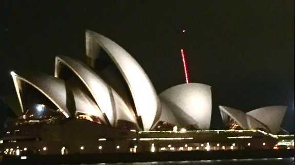 Giant red lightsaber flies by Sydney Opera House thrilling Star Wars fans