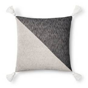 Bring a pop of style to any space with the Gray Tone Tassel Oversized Throw Pillow from Threshold™. With the two-tone design and tassel accents, this color blocked decorative pillow can instantly freshen up your living room or bedroom. Let it shine on its own, or mix it in with other pillows to create your own unique look.
