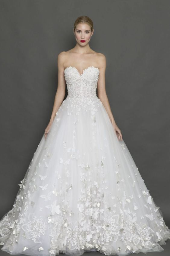 Glamorous strapless butterfly applique ballgown wedding dress; Featured Dress: Francesca Miranda