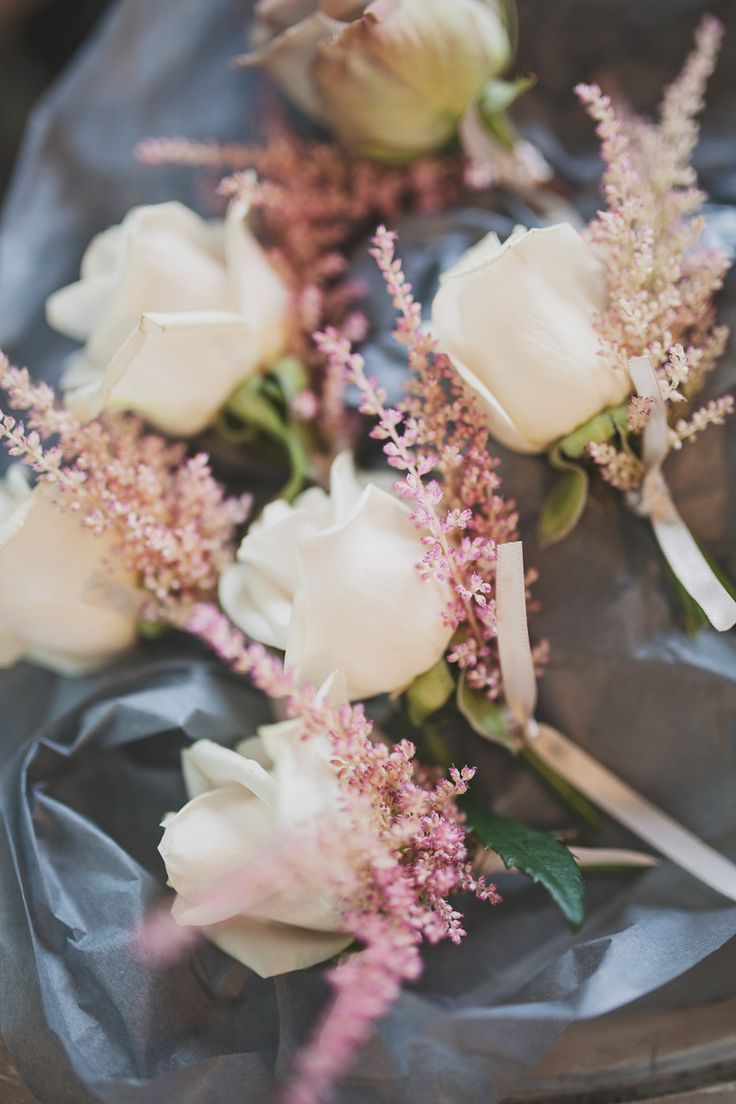 White Rose & Pink Buttonholes - Image by Katy Melling Photography - Jenny Packham 'Willow' gown for a beach wedding at Newton Hall in Northumberland with a pink rose bouquet by Katy Melling Photography.