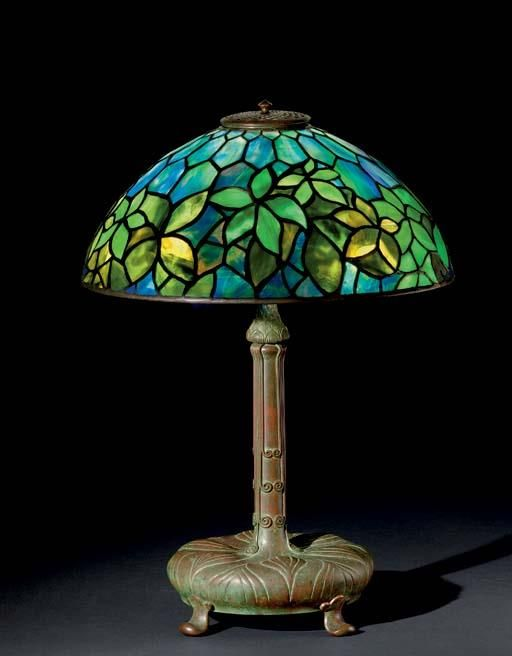 "Tiffany Studios, New York, Favrile Leaded Glass and Patinated Bronze ""Woodbine"" Lamp."