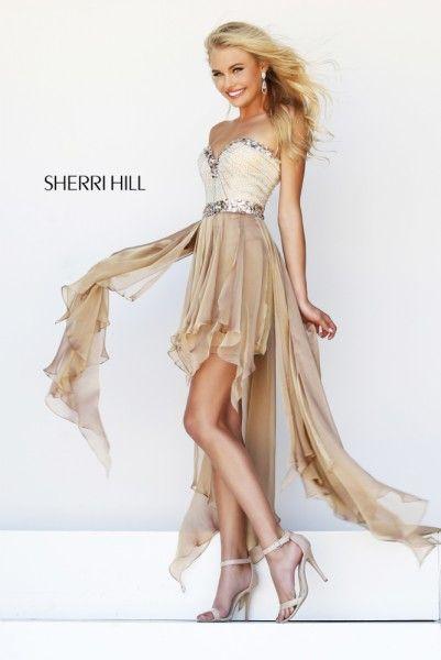Vestido corto en tonos dorados y ocres con falda con originales asimetrías